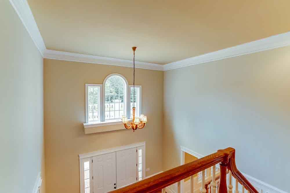 2nd floor view of Middleburg home front lobby with windows and chandelier