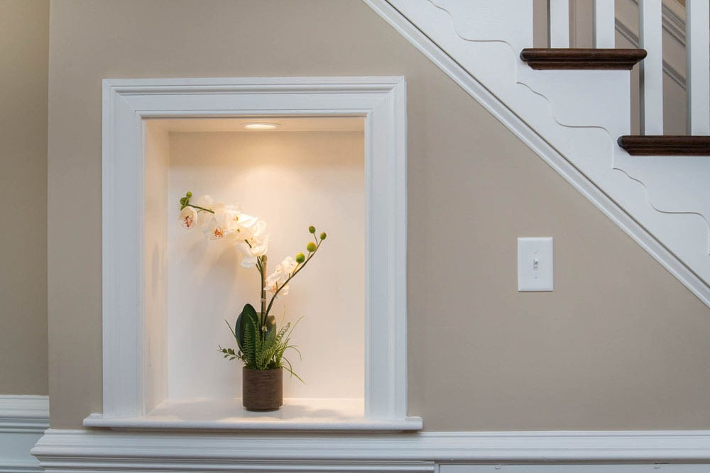 Area for decoration on side of stairs in Fairfax home
