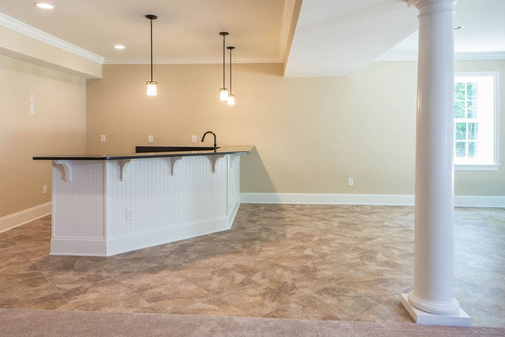 Basement bar in Fairfax home in corner with hanging lights