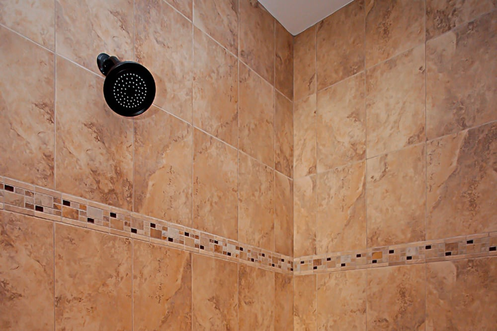 Brown stone shower inside Nokesville home
