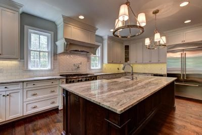 Close up of Haymarket kitchen island and white cabinets surrounding it