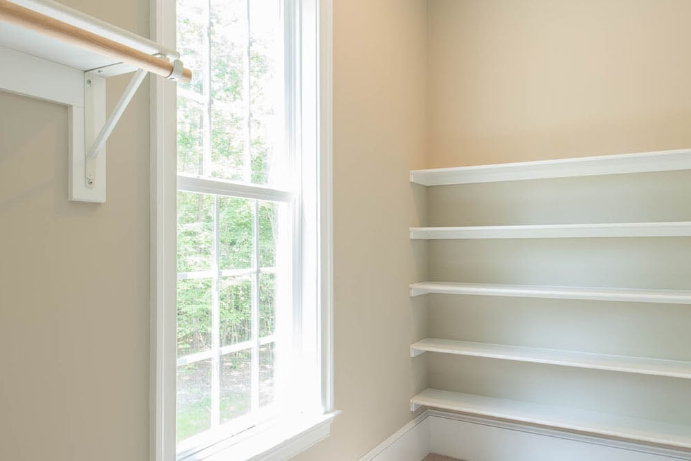 Closet area with window in Fairfax home