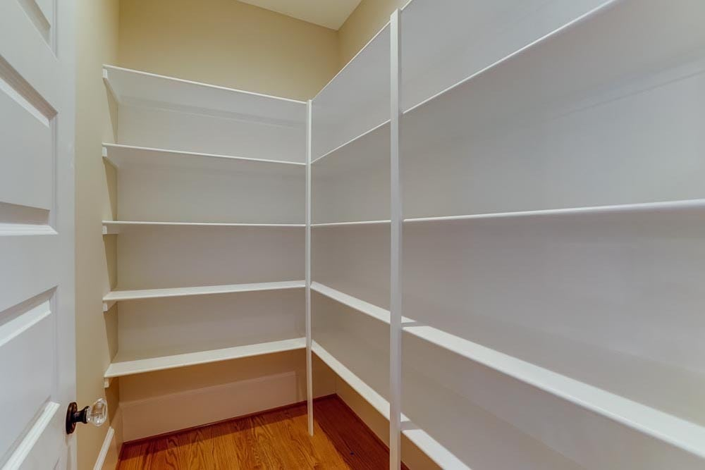 Closet in Middleburg home with white shelves
