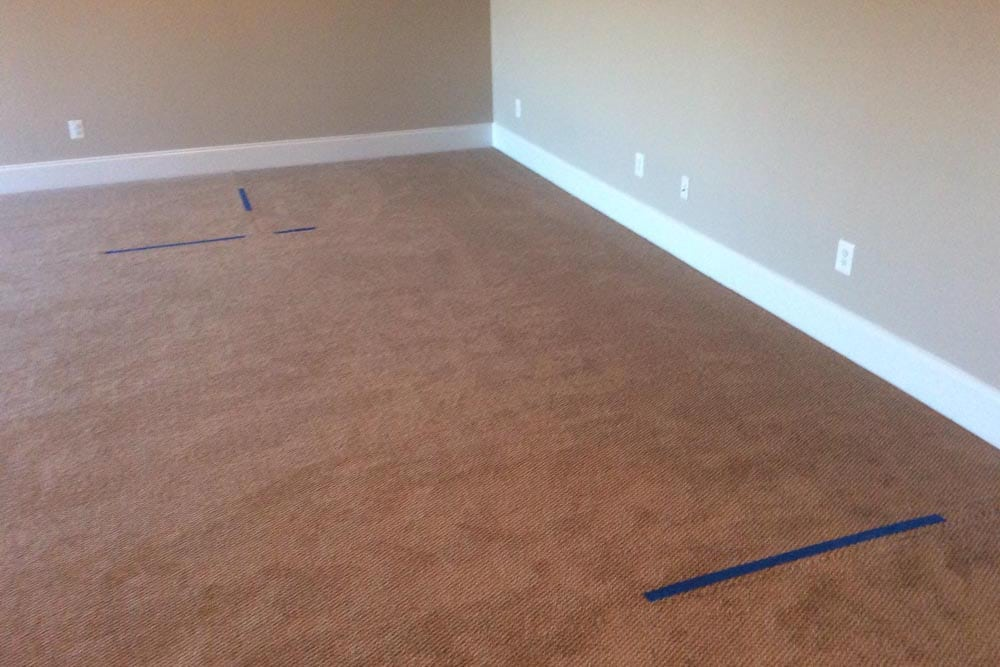 Corner of room in a house on The Plains with beige carpet and walls