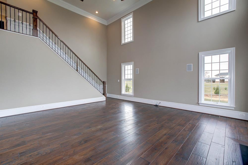Culpeper home den with stairs leading to 2nd floor