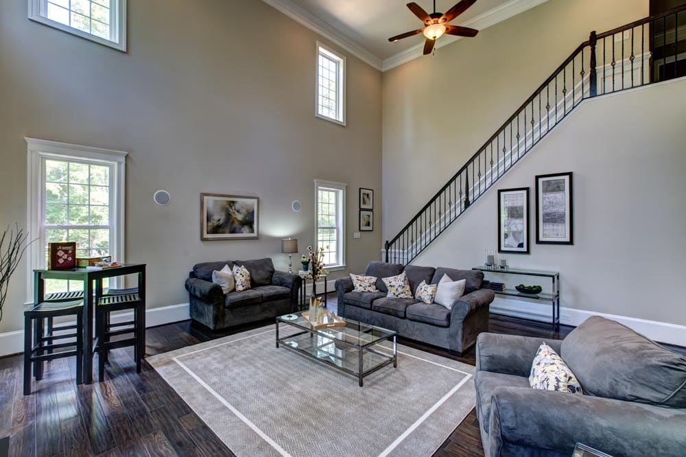 Den with stairs in view in new Ashburn home