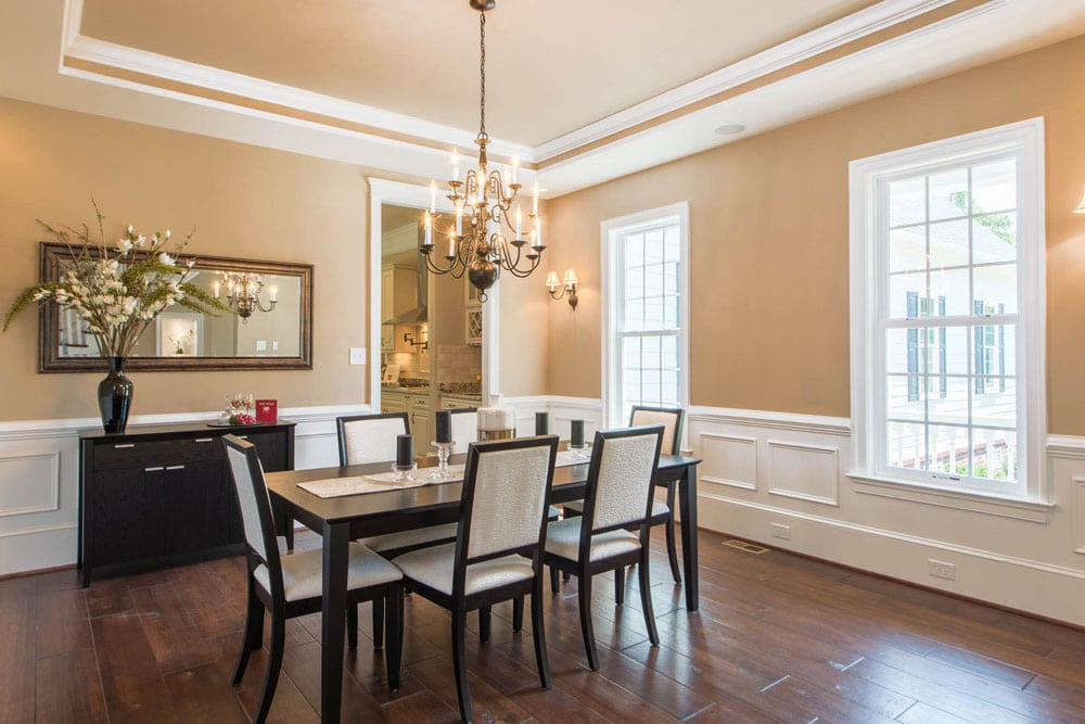 Dining room in Fairfax home with two windows and a chandelier