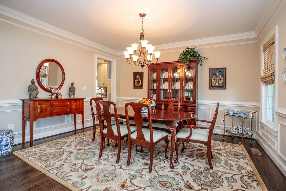 Dining room in Nokesville home with chandelier and wooden table and chairs