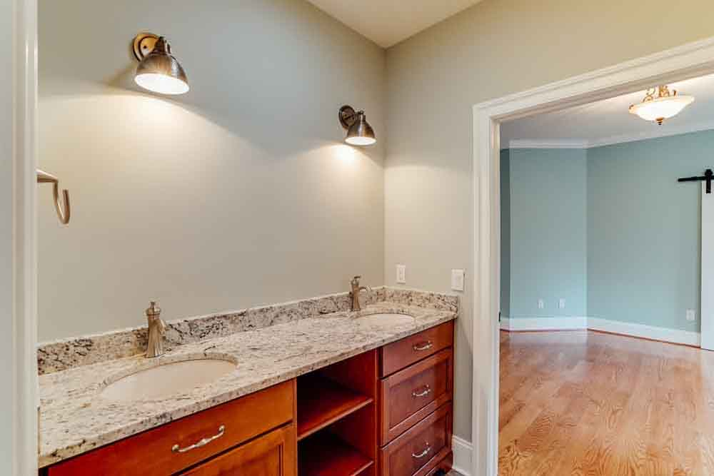 Double granite countertop sink adjoined to blue Middleburg room