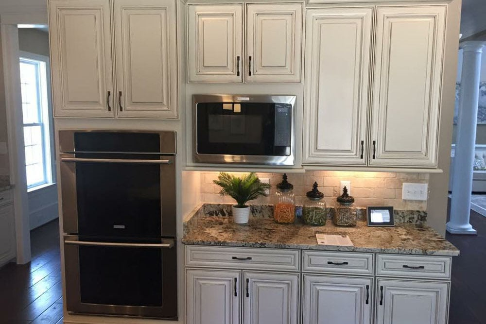 Double oven and microwave in Fairfax home kitchen