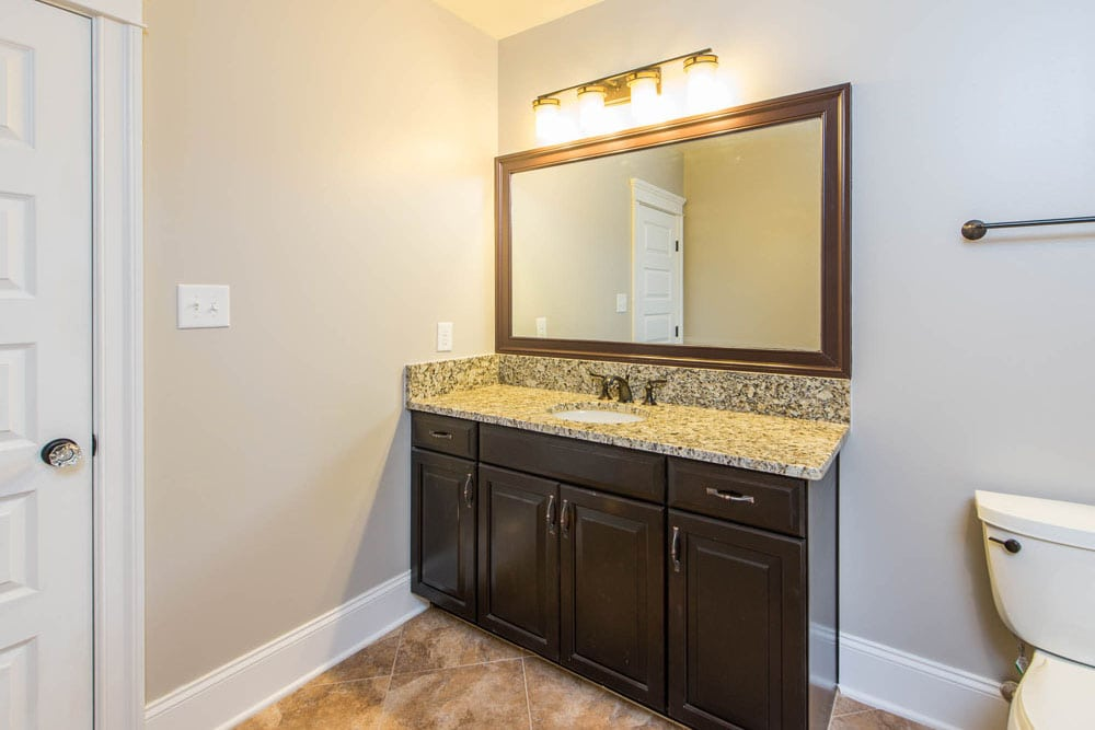Fairfax home bathroom with granite sink and a toilet