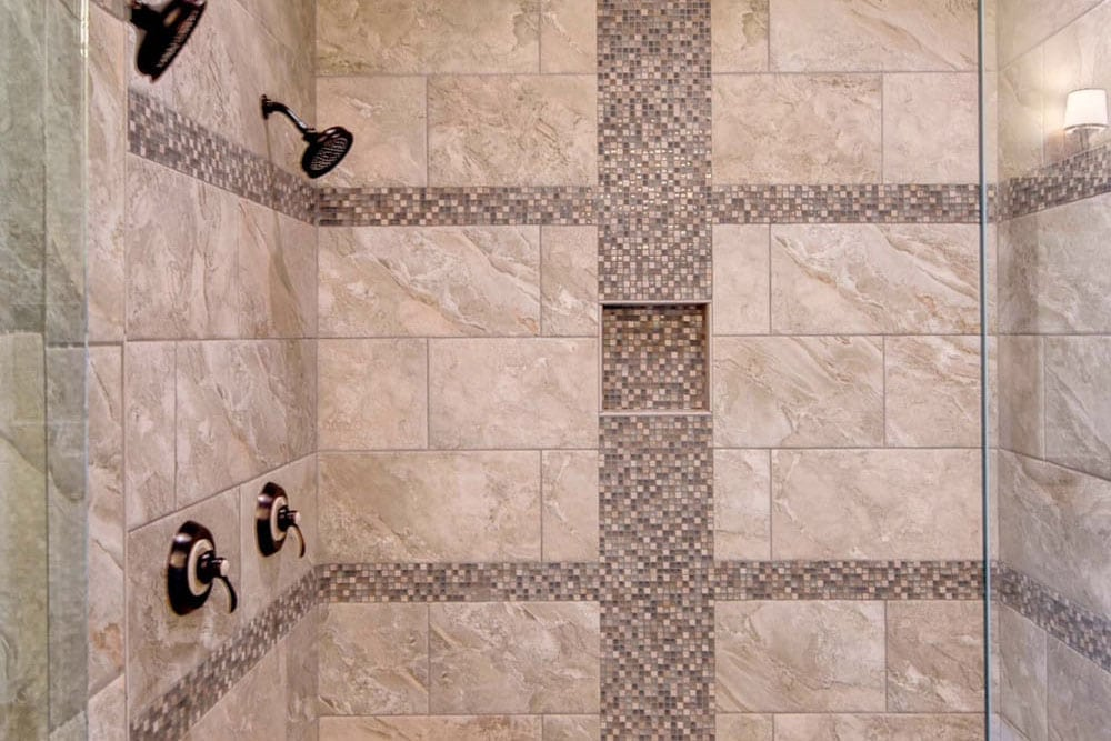 Fairfax home grey and brown tiled shower with rain shower head