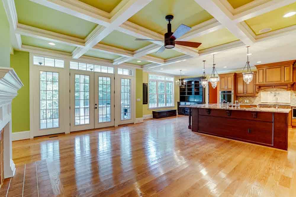 Family space in Middleburg home next to kitchen with large glass paneled doors leading outside