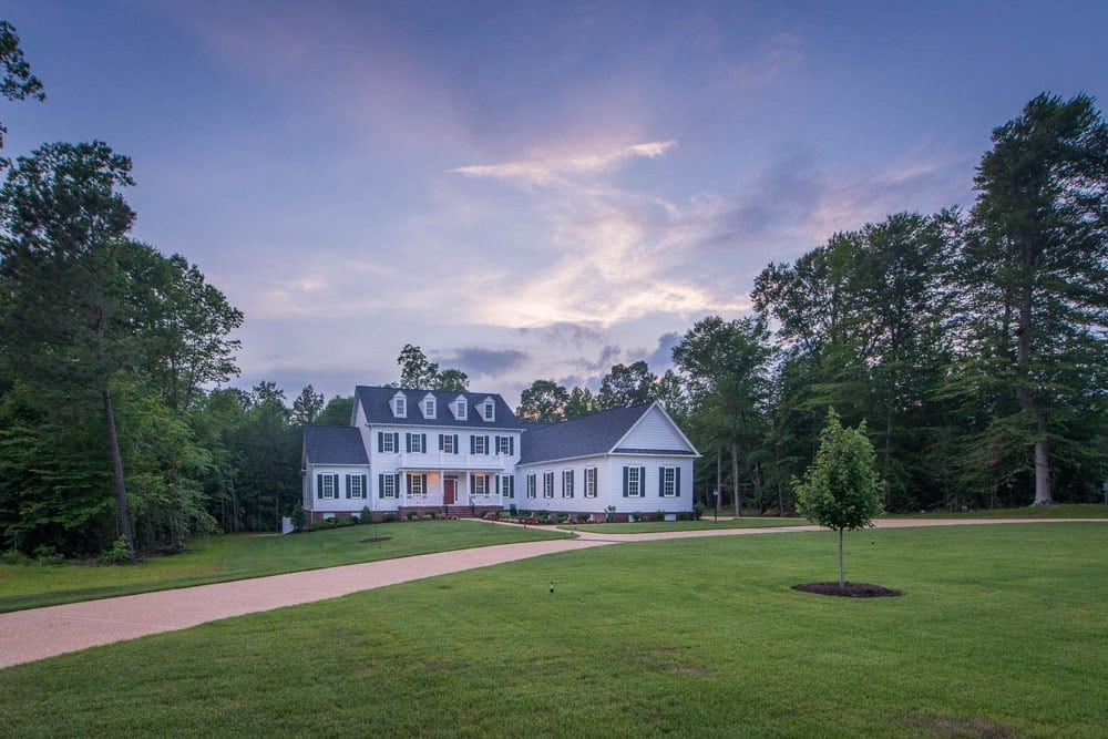 Far off view of Fairfax home with large swath of green grass