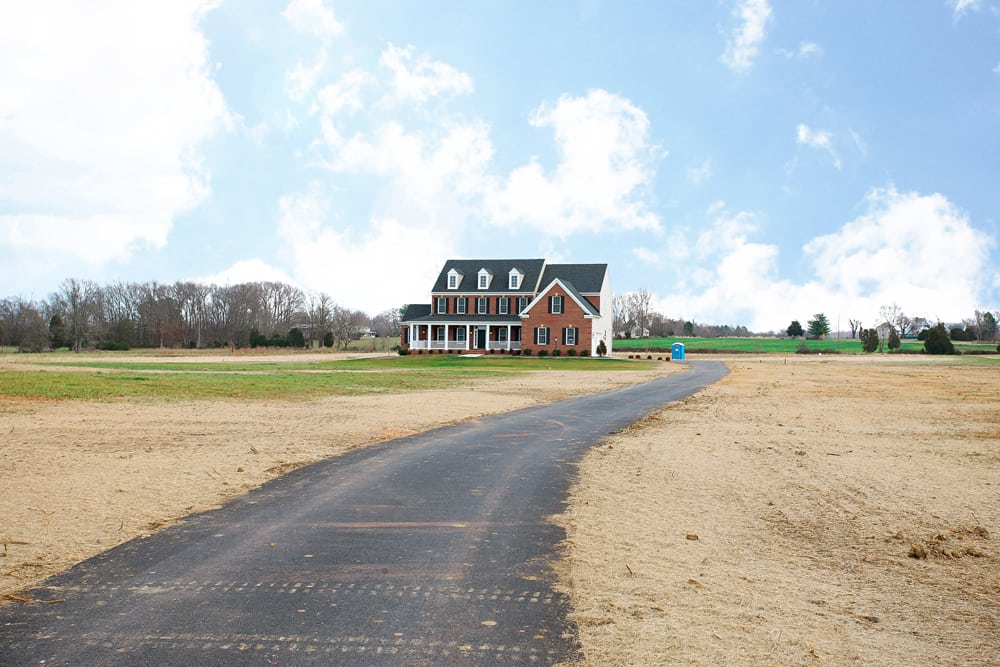 Far off view of Nokesville home with long driveway