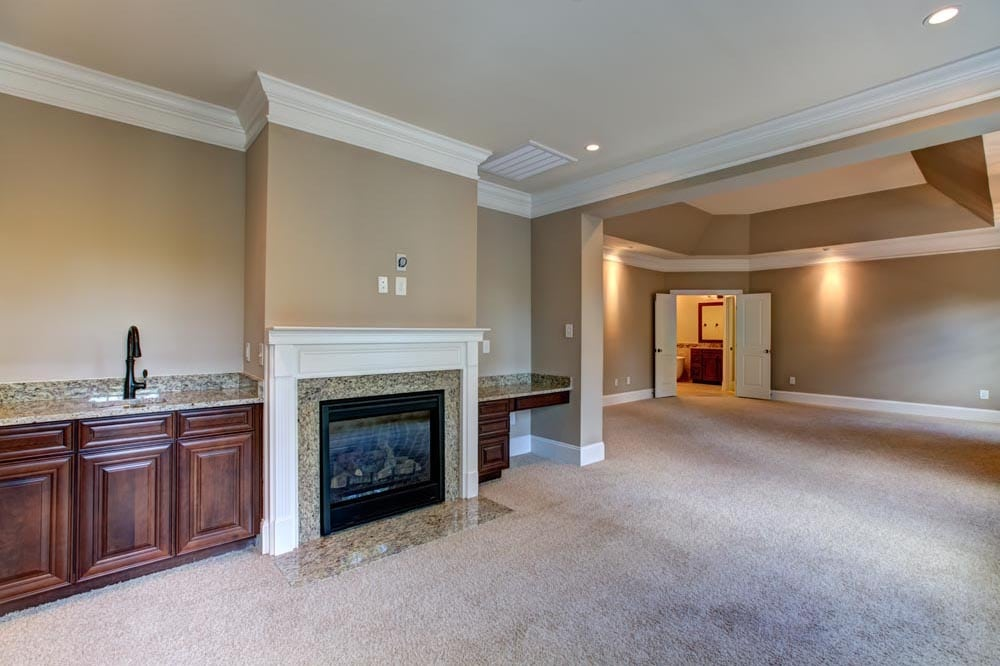 Fireplace and granite countertops room
