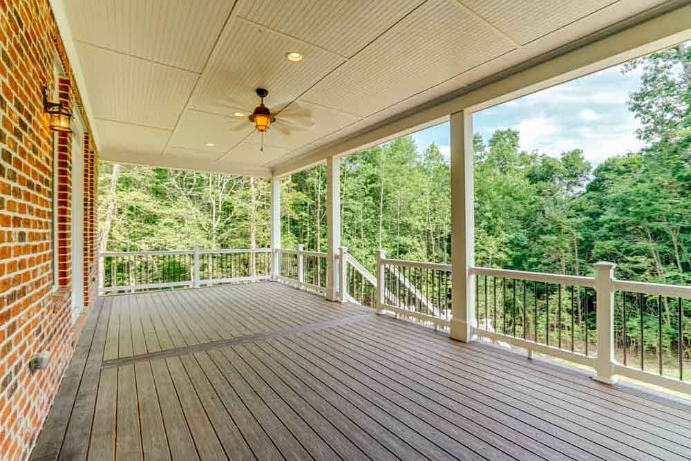 Front porch of Middleburg home with dark slats of wood and lights