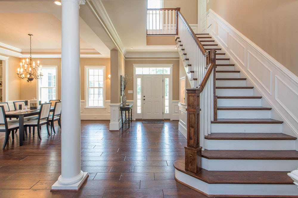 Front stairs and front door in Fairfax home with sitting room