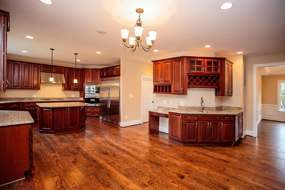 Full view of stained wood Warrenton kitchen with chandelier