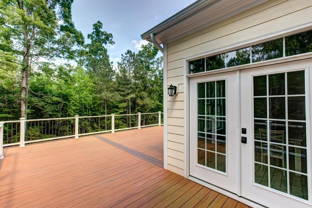 Glass panel doors leading into house from deck