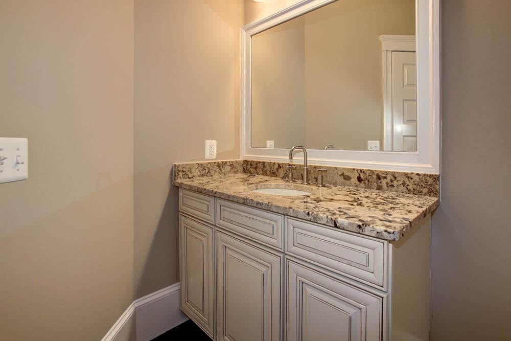 Granite countertop bathroom sink with white drawers