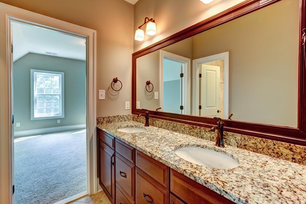 Granite countertop bathroom with two sinks
