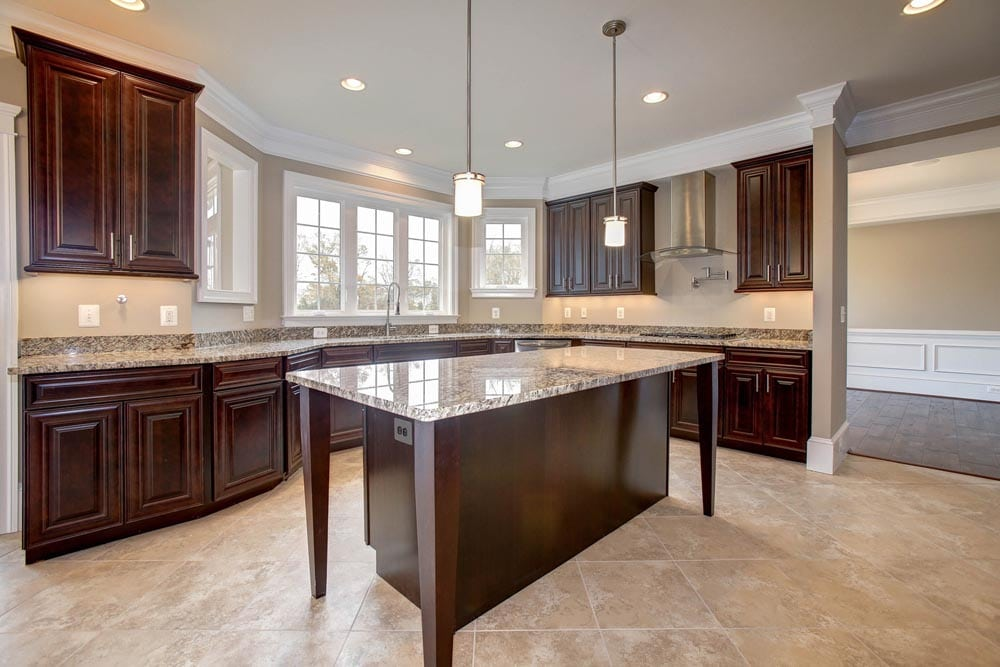 Granite countertop kitchen with island and brown wood cabinets