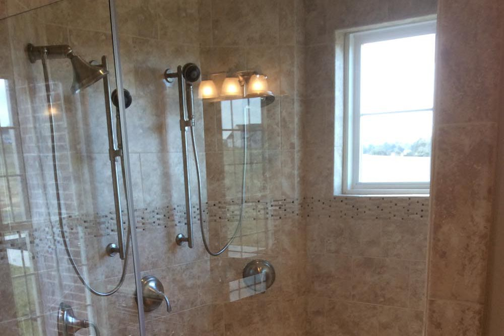 Granite shower with removable showerhead and glass door in a house on The Plains