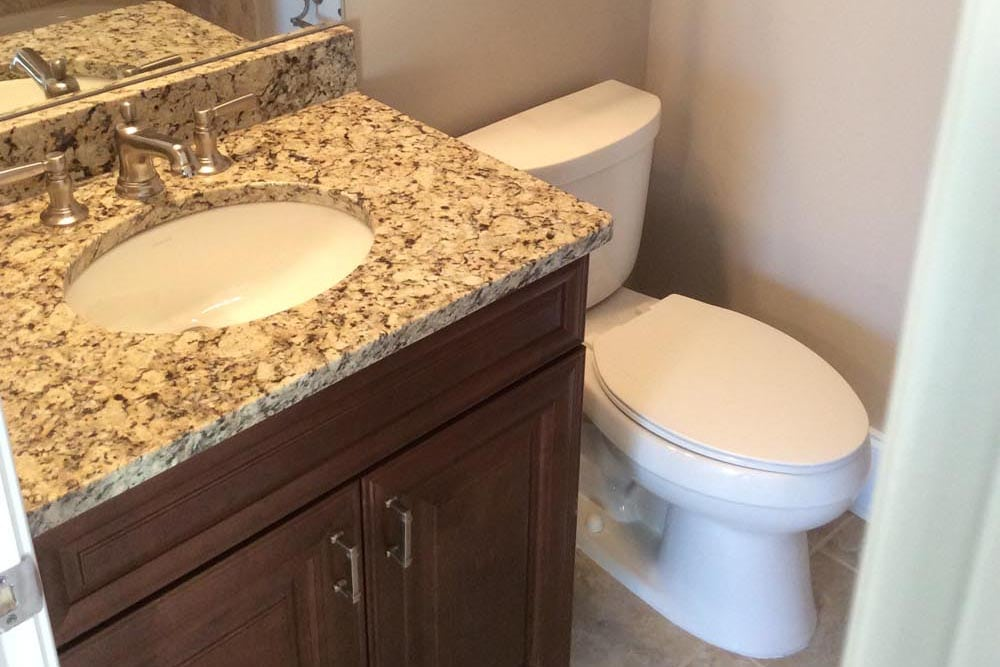 Guest bathroom in a house on The Plains with single grantie countertop sink next to toilet