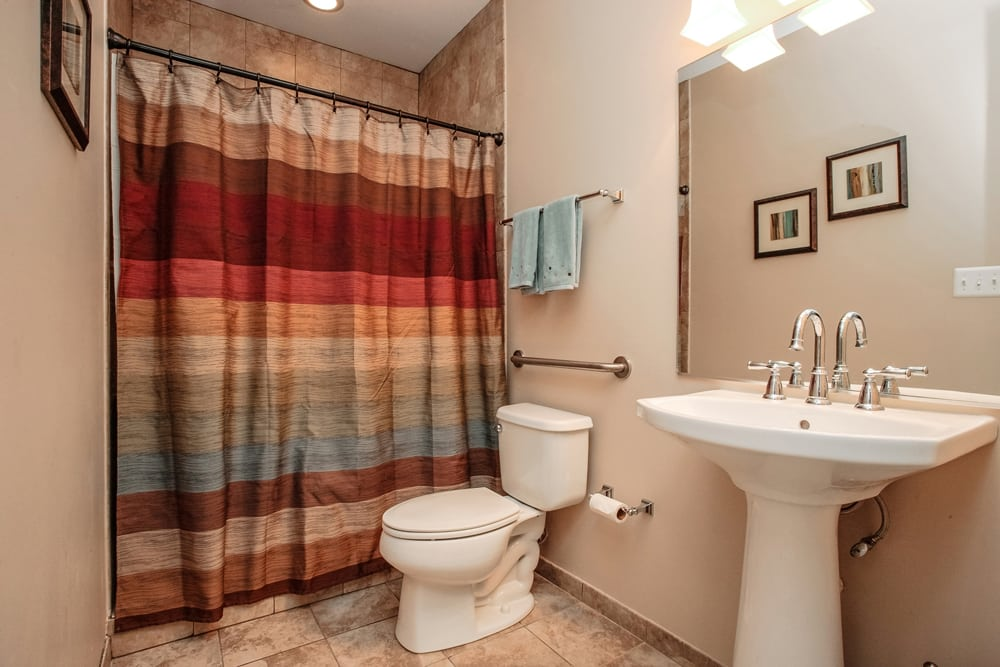 Guest bathroom with curtained shower