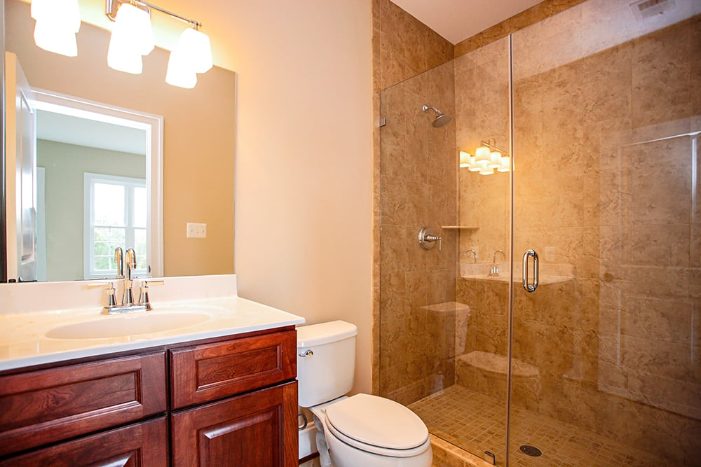 Guest bathroom with toilet and shower inside Warrenton house