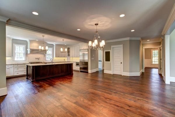 Haymarket home dining area with chandelier in front of kitchen island