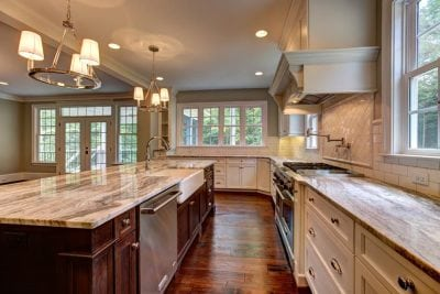 Haymarket kitchen with double oven and stove with hood