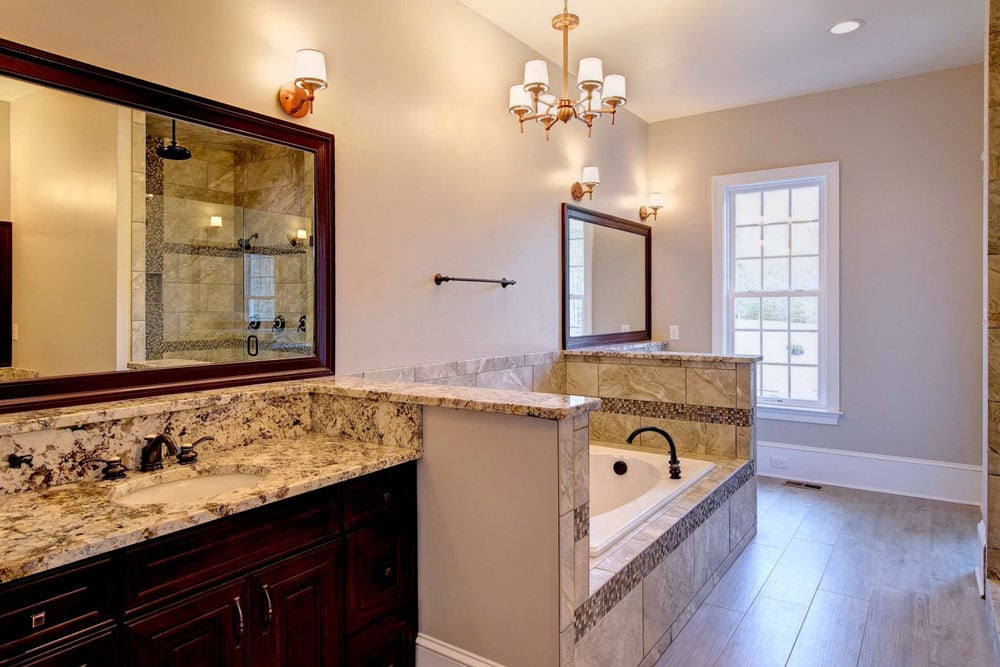 In ground bathtub in Fairfax home with view of sinks on either side