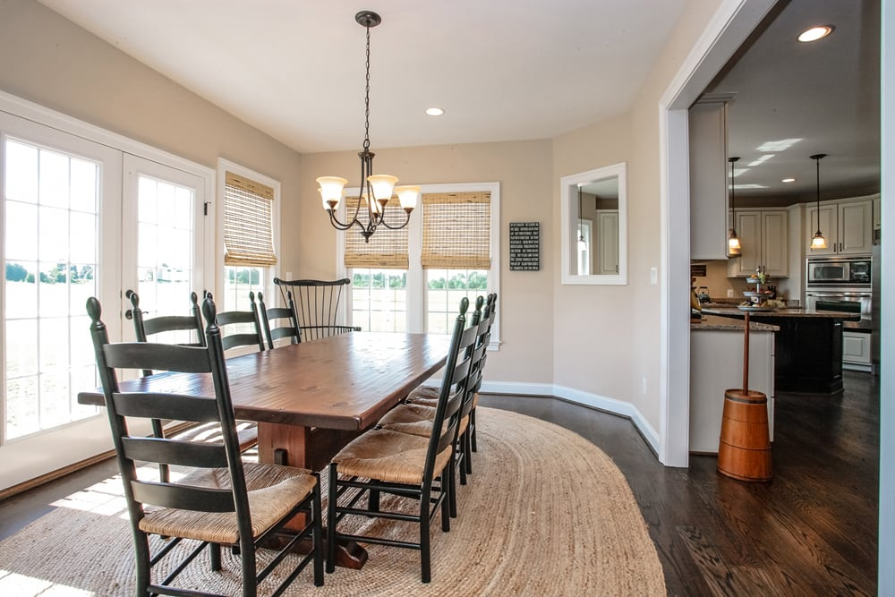 Kitchen dining room with dark stained furniture