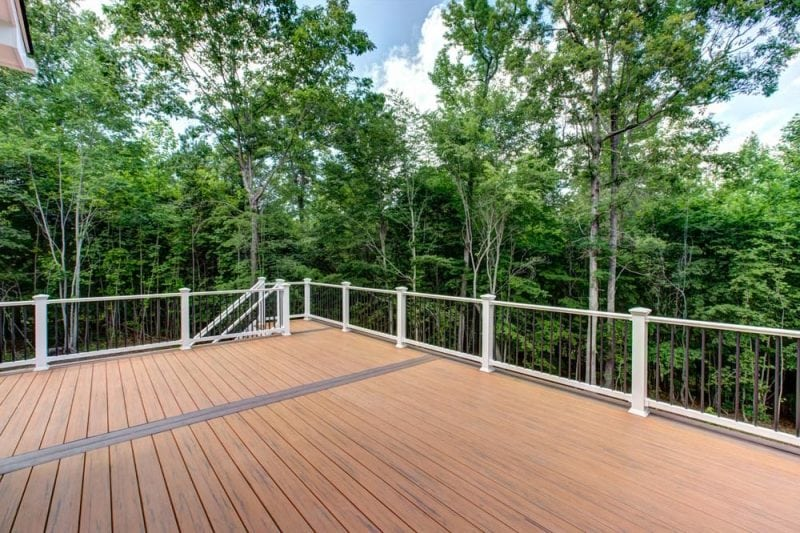 Large back deck with white railing