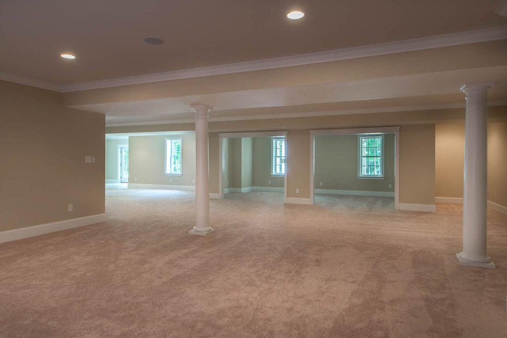 Large basement in Fairfax home with pillars