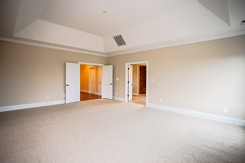 Large carpeted room with two sets of double doors upper level of Warrenton house