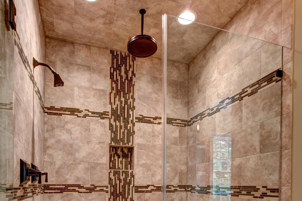 Large grey, white, and brown stone shower