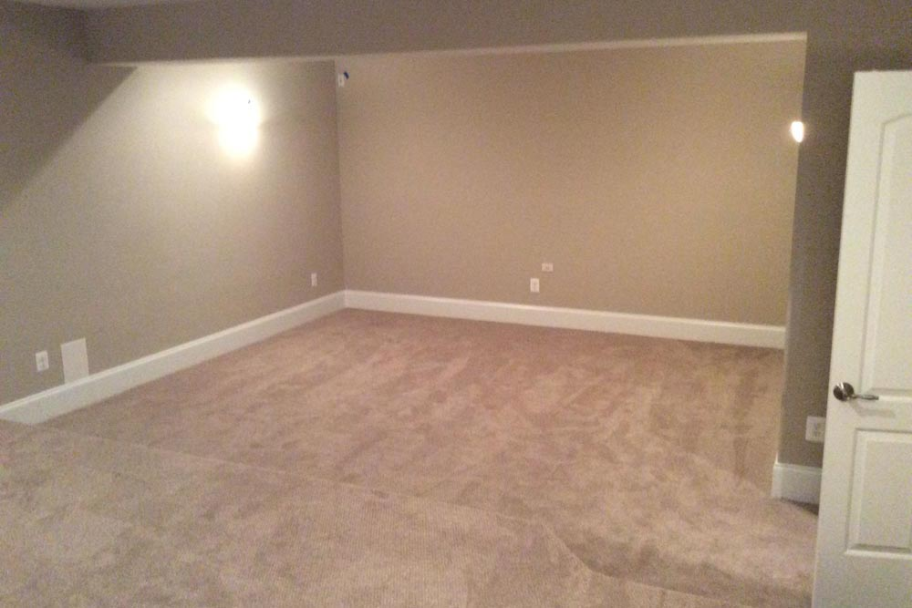 Large open carpeted area in a house on The Plains