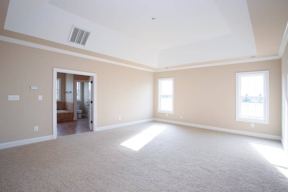 Large room in Nokevsville home with white carpet, two windows, and light pink walls