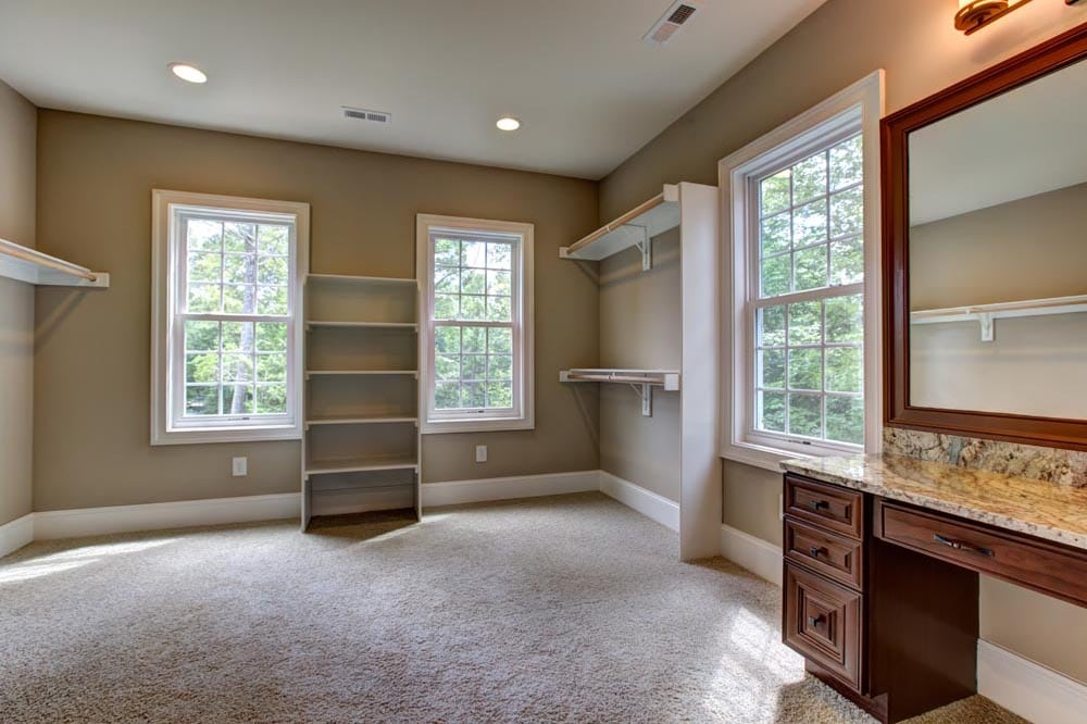 Large room with storage space and countertop with mirror