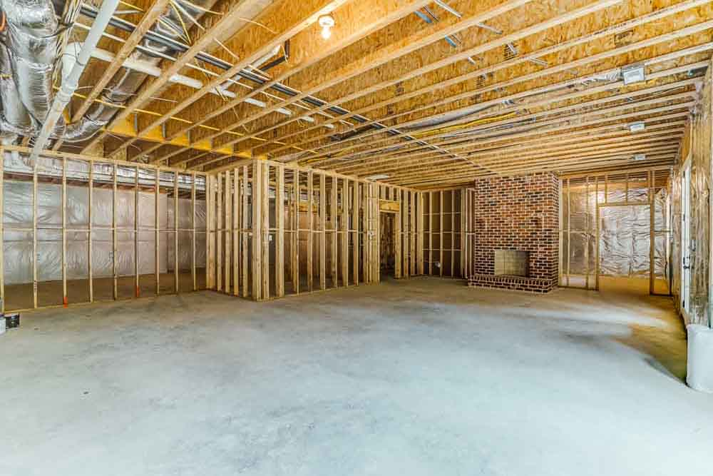 Large unfinished room with brick fireplace