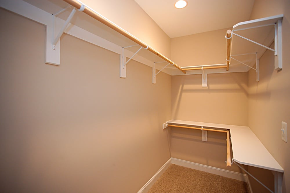 Large walk-in closet with shelves inside Nokesville home