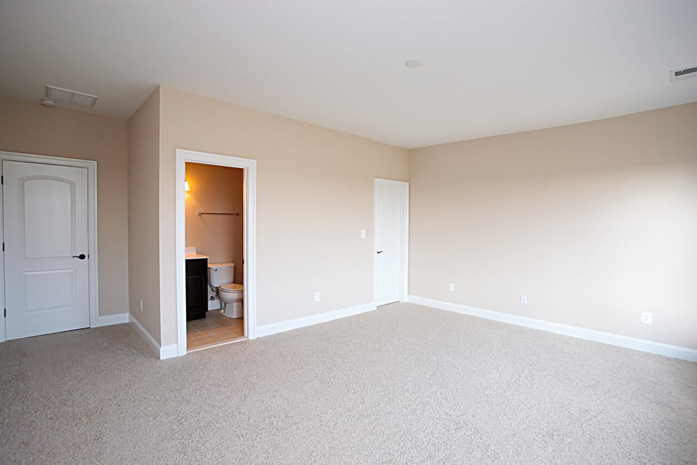Large white carpet room with bathroom inside Nokesville home