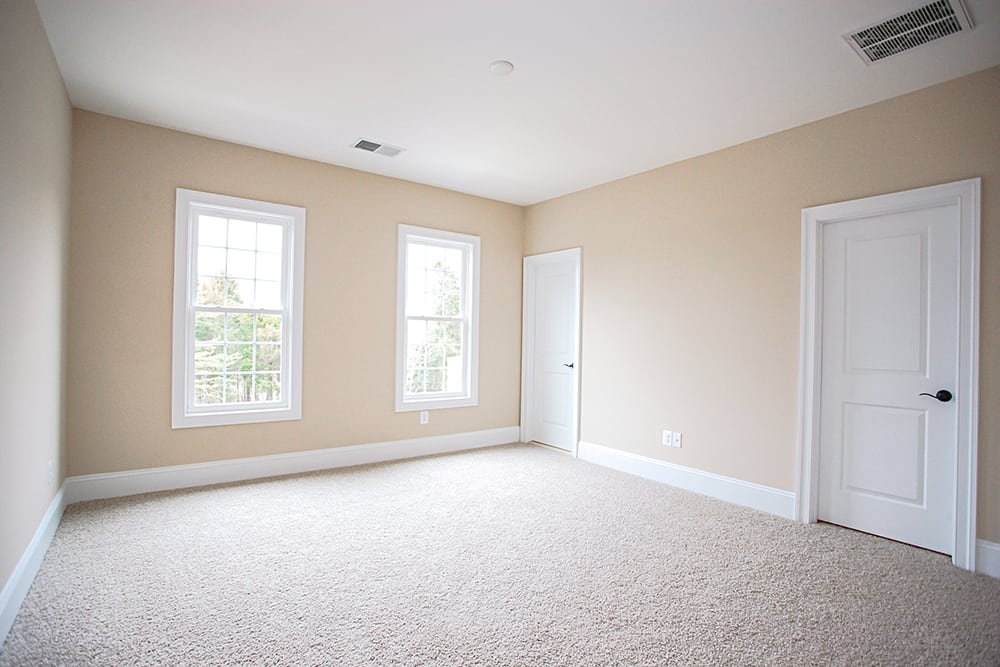 Large white carpet room with closet in Warrenton house