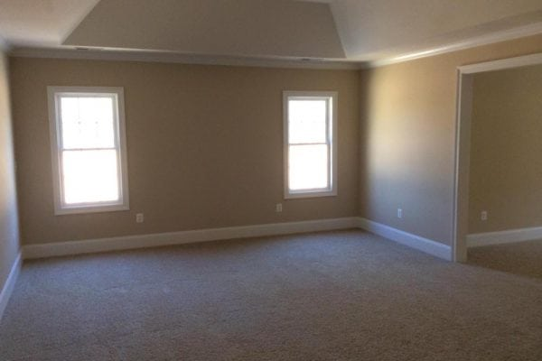 Master bedroom with alcove in round hill home