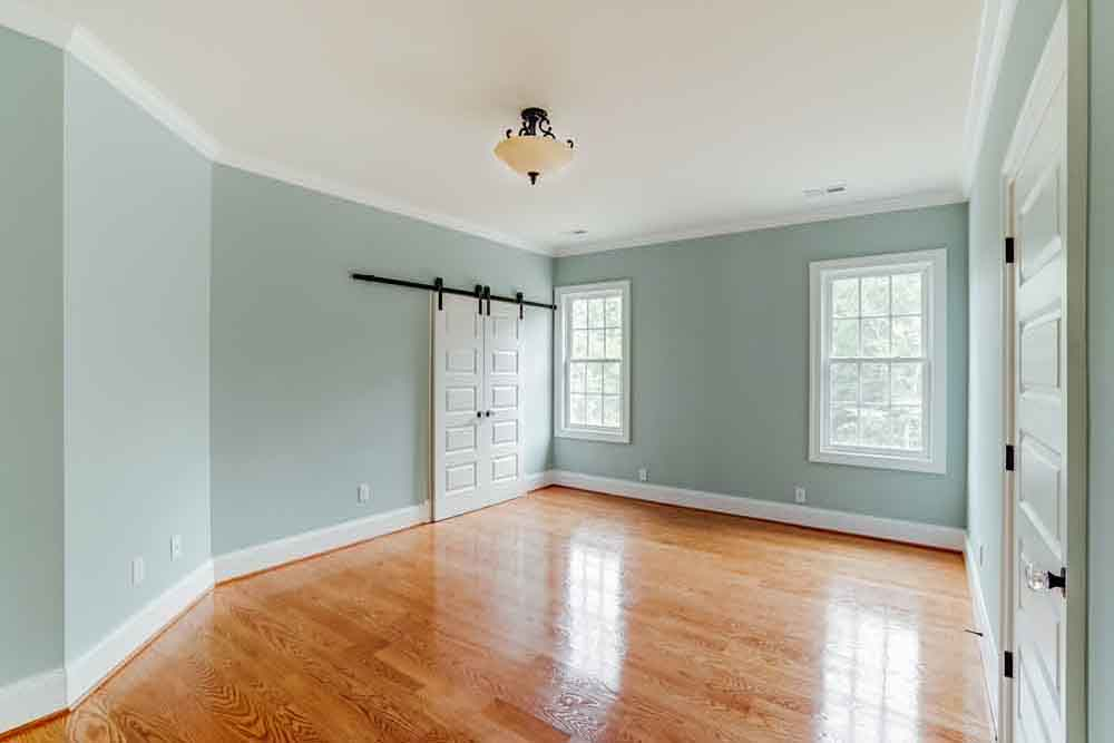Light blue room with two windows in Middleburg home