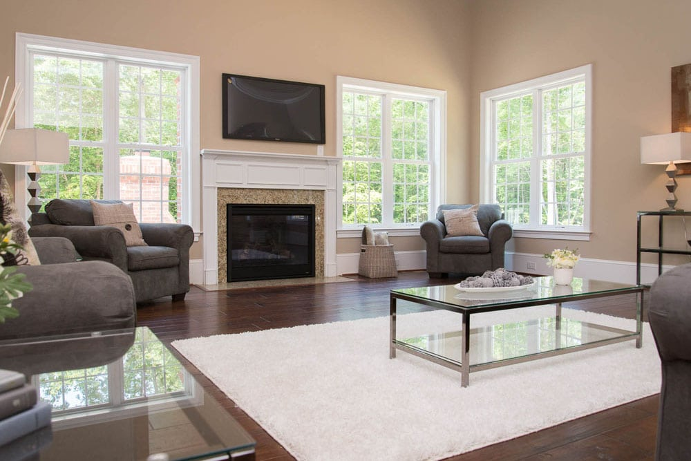 Living room in Fairfax home with fireplace and windows