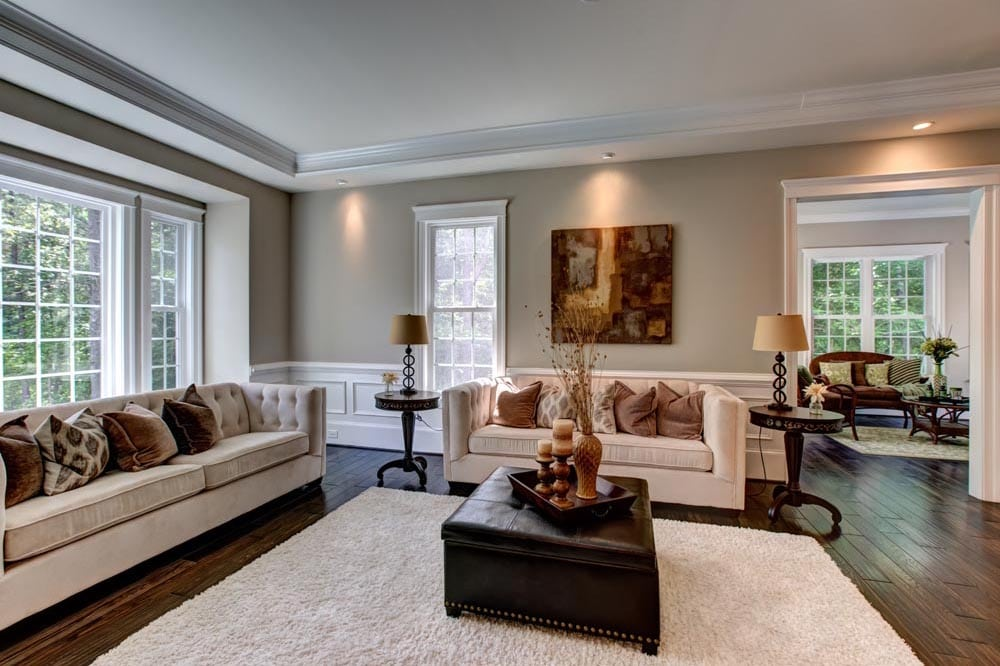 Living room with beige couches